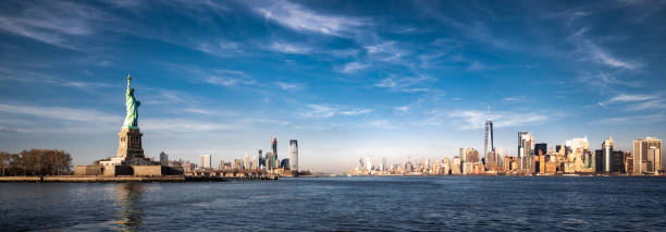 Panoramic view of New York City and the Statue of Liberty Panoramic view of New York City, Jersey City and the Statue of Liberty. liberty island stock pictures, royalty-free photos & images