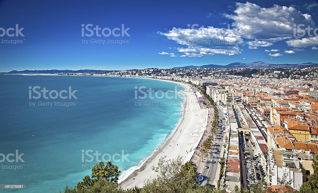 Panoramic view of Nice coastline and beach with blue sky. stock photo