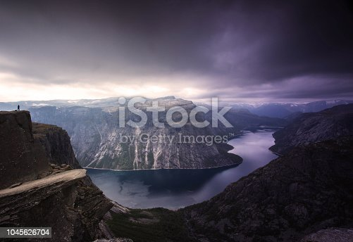 Panoramic view of norway landmark trolltunga, with fjord, lake and cloud sky. Tourism concept nature