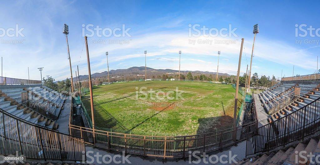 Panoramic view of old abandoned baseball stadium stock photo