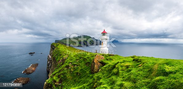 istock Panoramic view of old lighthouse on the Mykines island 1217949591