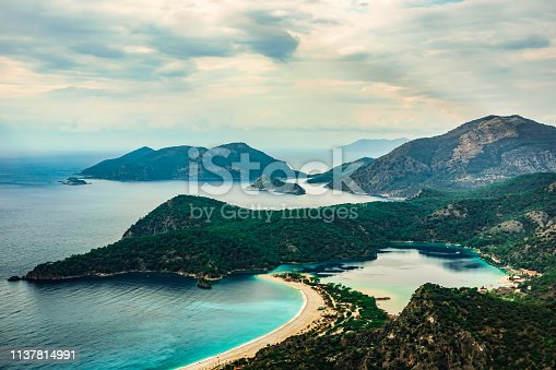 istock Panoramic view of Oludeniz Beach and bay, Fethiye,  Mugla, Turkey. Aerial Photo from Lycian way. Summer and holiday concept. 1137814991