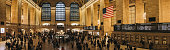 New York, USA - May 31, 2018: Panoramic view of people walking inside Grand Central Terminal, a world-famous landmark and transportation hub in Midtown Manhattan, New York.