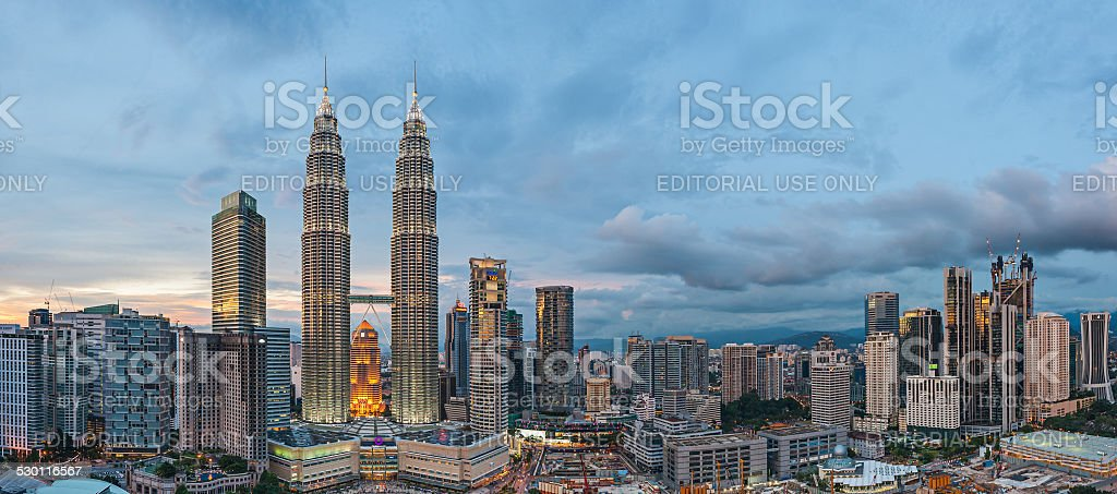 Panoramic View of Petronas Twin Towers, Kuala Lumpur before blue stock photo