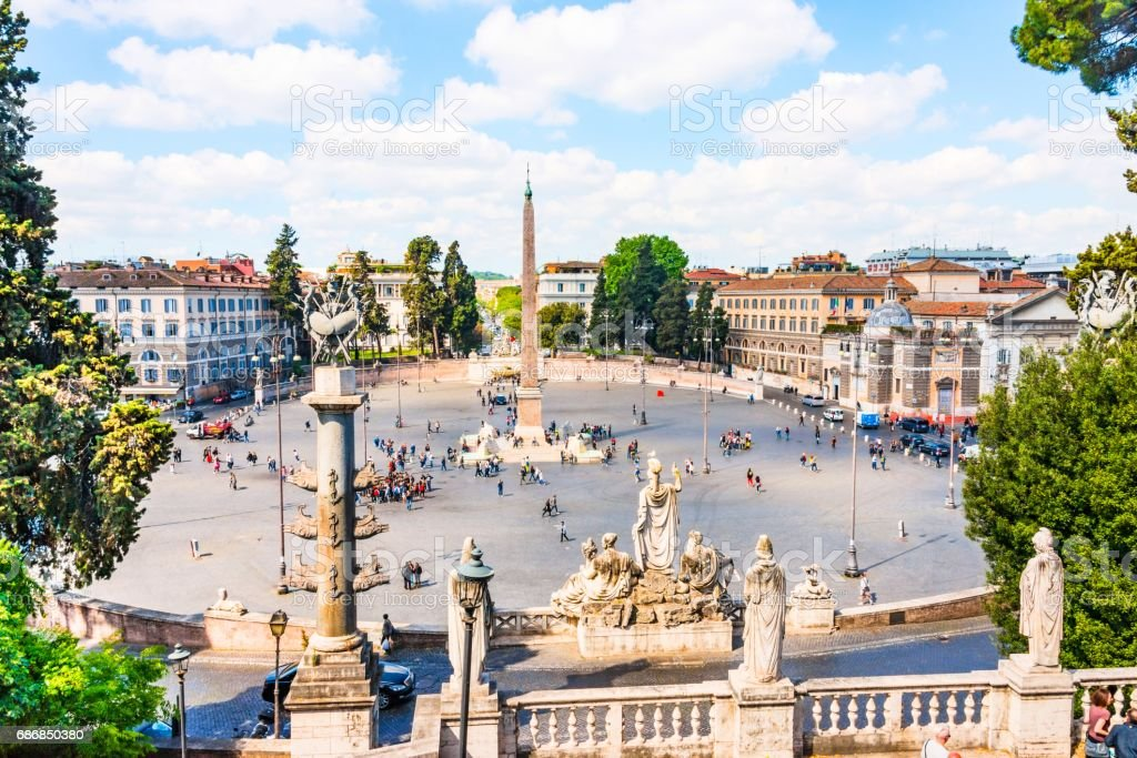 Panoramic view of Piazza del Popolo with tourists sightseeing. stock photo