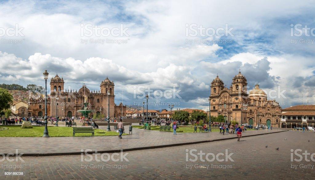 Panoramic view of Plaza de Armas with Inca fountain, Cathedral and Compania de Jesus Church - Cusco, Peru stock photo