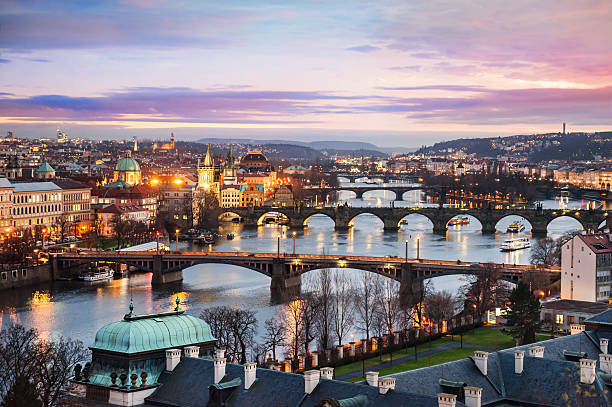 Panoramic view of Prague at night Panoramic view of bridges on Vltava river in Prague at night prague stock pictures, royalty-free photos & images
