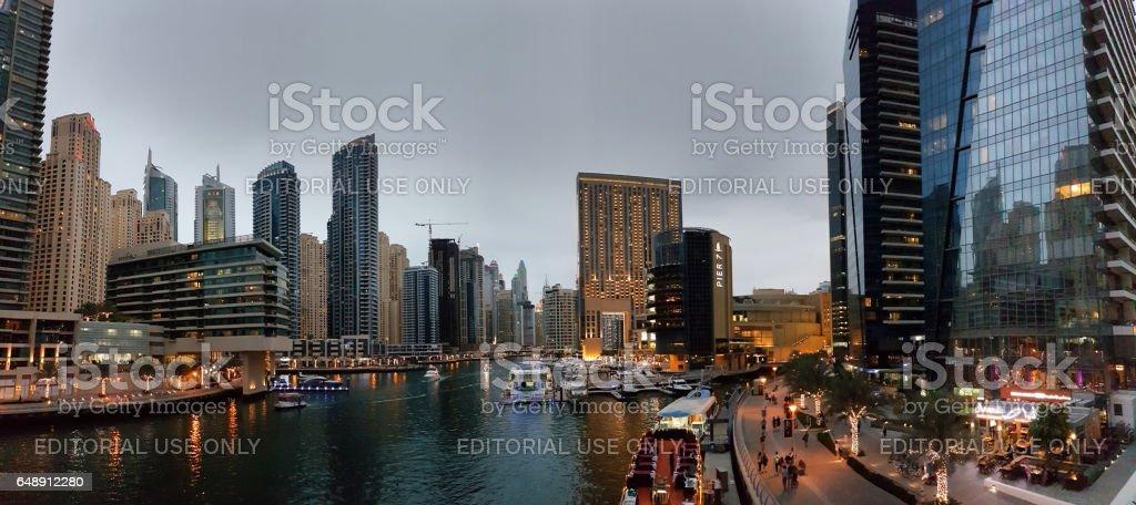 Panoramic view of promenade of Dubai Marina at evening stock photo