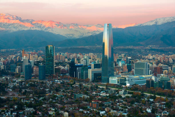 Panoramic view of Providencia and Las Condes districts with The Andes Mountain Range at sunset in Santiago stock photo