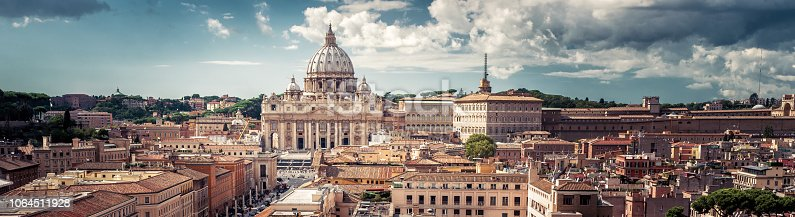 Panoramic view of Rome with St Peter's Basilica in Vatican City, Italy. Beautiful Roma skyline. Nice panorama of Rome from above. Rome cityscape with landmark in summer. Horizontal banner with Rome.