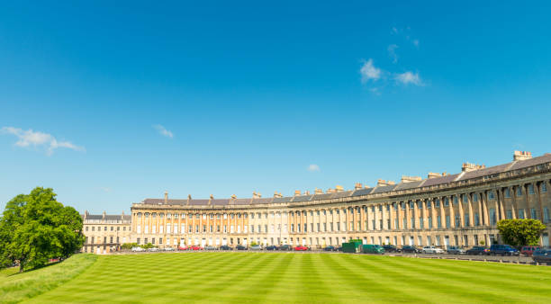 Panoramic view of Royal Crescent in Bath, England A view of the famous curving Georgian street, Royal Crescent in Bath, Somerset. bath england stock pictures, royalty-free photos & images