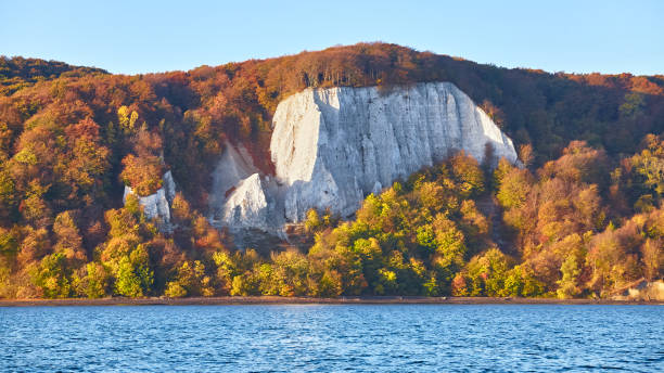 Panoramic view of Rugen Island chalk cliffs at sunrise, Germany. stock photo