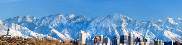 panoramic view of salt lake city with snow capped mountain - skyline mountains usa stock photos and pictures