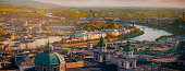Panoramic view of Salzburg skyline historic city of Salzburg with Salzach river in beautiful golden evening light sky and colorful of autumn at sunset,Salzburger Land, Austria