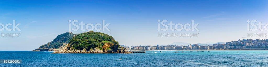 Panoramic view of Santa Clara Island at San Sebastian coastline and bay. Donostia, Basque Country, Spain royalty-free stock photo