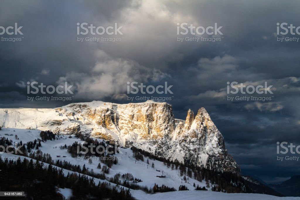 Panoramic view of Sciliar mountain during a cloudy day with sun stock photo