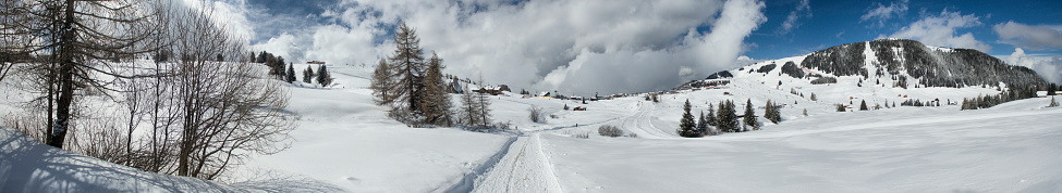 istock Panoramic view of Seiser Alm with Bullaccia mountain on the left from snowy road 944670408