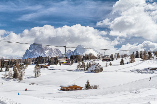 istock Panoramic view of Seiser Alm with Langkofel mountain in background and a chair lift in foreground 1048178820