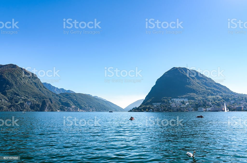 Panoramic view of serene Lugano lake surrounded by hills, Morcote stock photo