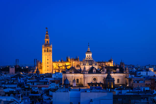 panoramic view of Seville skyline with Giralda tower at background, Spain historical Giralda tower view from old town santa cruz seville stock pictures, royalty-free photos & images