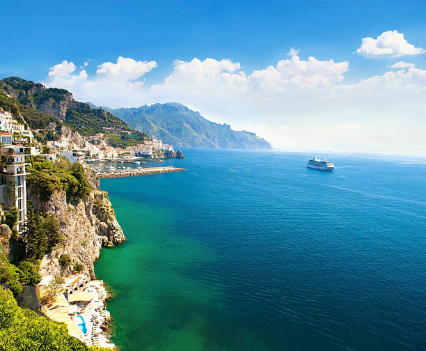 Panoramic view of small town and the sea Panoramic view of the small town and the sea. Italy, Amalfi.   mediterranean sea stock pictures, royalty-free photos & images