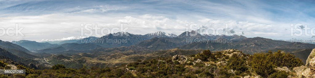 Panoramic view of snow capped mountains of northern Corsica royalty-free 스톡 사진