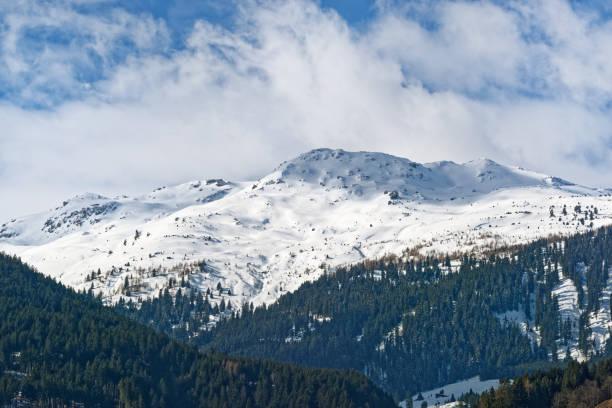 Panoramic view of snow covered mountain range stock photo