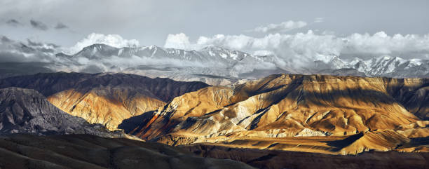 Panoramic view of snow mountains range landscape. stock photo