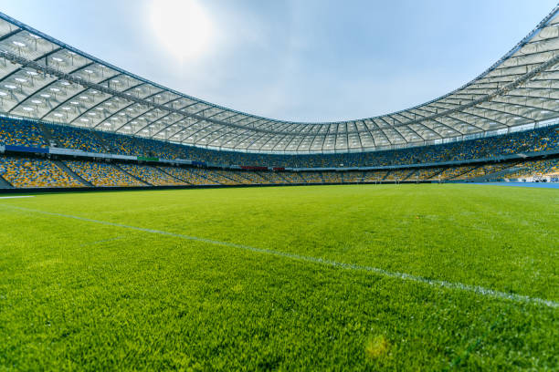 panoramic view of soccer field stadium and stadium seats - soccer stock photos and pictures