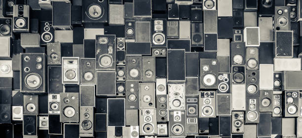 Panoramic view of speakers hanging on the wall in monochrome vintage style stock photo