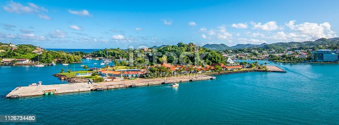 Colorful image of Castries, cruise harbor of Saint Lucia in the Caribbean. Sea, buildings at the pier  and blue sky on a beautiful summer day.
