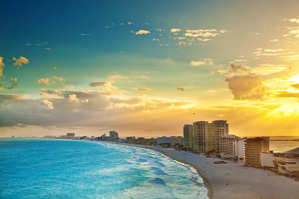 panoramic view of sunset at the hotel district, cancun mexico - caribbean culture stock pictures, royalty-free photos & images