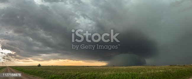 858837068istockphoto Panoramic view of supercell thunderstorm over the high plains in Oklahoma with a dramatic green sky. 1127158975