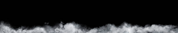 panoramic view of the abstract fog or smoke move on black background. white cloudiness, mist or smog background. - fog stock pictures, royalty-free photos & images