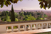 Panoramic view of the Alhambra, Granada, Spain. As seem from generalife, early in the evening\nMuslim dynasties ruled Granada from 711. The Nasrids – one of the Muslim dynasties – valued luxury and ease, and have left behind a number of buildings in Granada that indicate their appreciation for life's finer pleasures. Among these is the Alhambra; the most well-known. Today, the Alhambra's beauty derives primarily from the 13th and 14th centuries, when the founder of the Nasrid dynasty relocated his court there.
