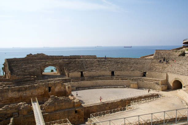 A panoramic view of the ancient roman amphitheater next to the Mediterranean sea stock photo