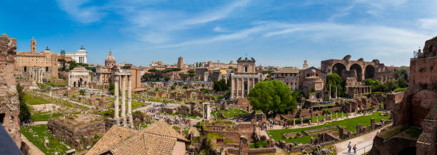 Panoramic view of the ancient ruins of the Roman Forum in Rome Rome, Italy - April, 2018: Panoramic view of the ancient ruins of the Roman Forum in Rome roman forum stock pictures, royalty-free photos & images