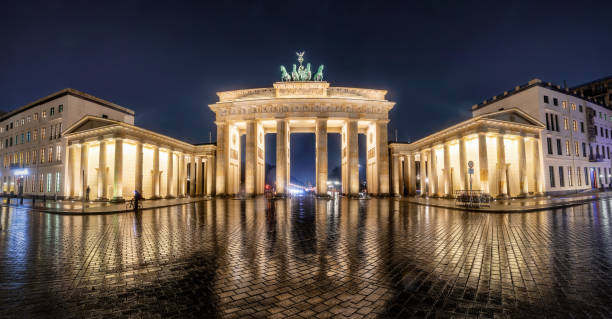 Panoramic view of the Brandenburg Gate in Berlin, Germany, during night stock photo