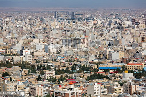 Panoramic view of the building density of Qom city, Iran. Dense urban development, unfinished houses, general view of the modern part of the city