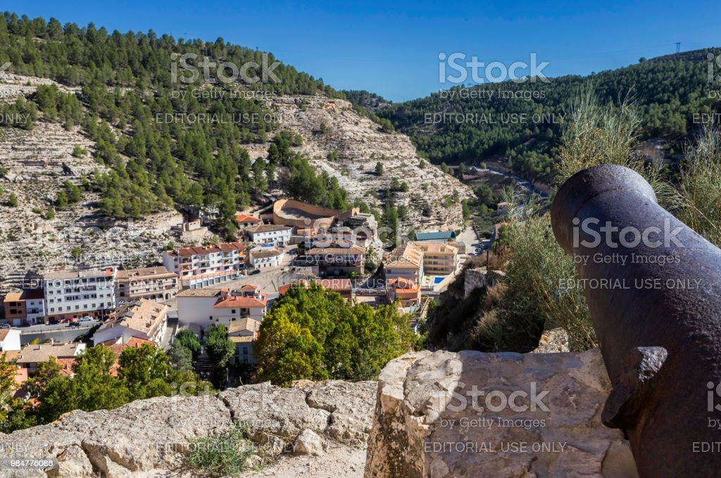 Panoramic view of the city, at the bottom of the bullring in the form of a boat, artillery cannon from the castle, fortress of Almohad origin, take on Alcala del Jucar, Spain stock photo