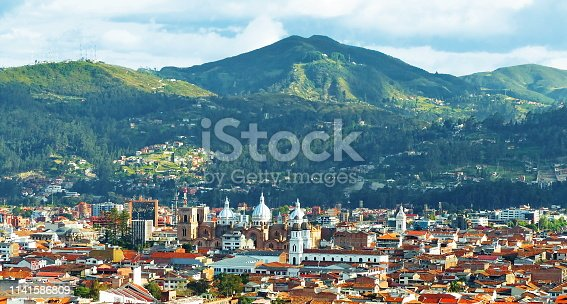Aerial panoramic view of the city Cuenca, Ecuador, located in the valley of four rivers with its many churches and surrounding mountains