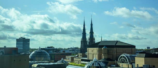 een panoramisch uitzicht over de stad van bovenaf. eindhoven, netherlands. - eindhoven city stockfoto's en -beelden