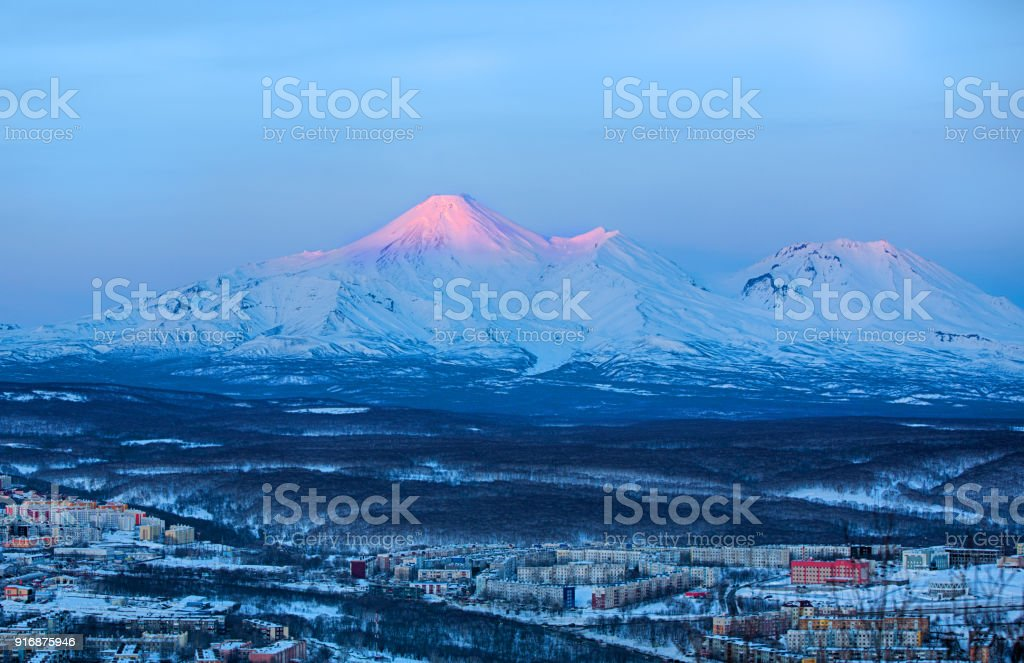 Panoramic view of the city Petropavlovsk-Kamchatsky and volcanoes stock photo