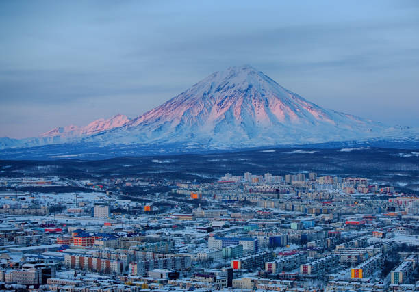 Panoramic view of the city Petropavlovsk-Kamchatsky and volcanoes Panoramic view of the city Petropavlovsk-Kamchatsky and volcanoes: Koryaksky Volcano, Avacha Volcano, Kozelsky Volcano. Russian Far East, Kamchatka Peninsula. kamchatka peninsula stock pictures, royalty-free photos & images
