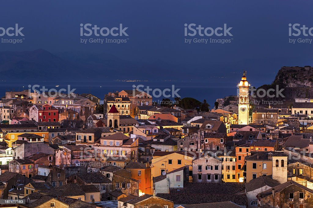 Panoramic view of the citylights, Corfu Town at night. stock photo