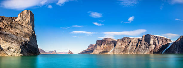 Panoramic view of the cliffs and mountains in Buchan Gulf, Baffin Island, Canada. stock photo