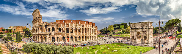 Panoramic view of the Colosseum and Arch of Constantine, Rome Panoramic aerial view of the Colosseum and Arch of Constantine, Rome, Italy coliseum rome stock pictures, royalty-free photos & images