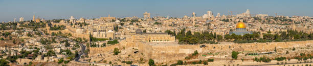 Panoramic View of the Contrast Between the New and the Old City of Jerusalem Panoramic View of the Contrast Between the New and the Old City of Jerusalem muslim quarter stock pictures, royalty-free photos & images