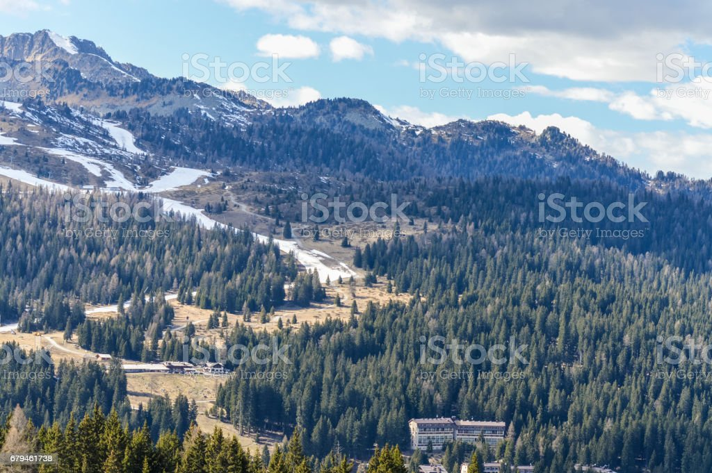 Panoramic view of the Dolomites Alps Mountains near Trento in Italy with ski slopes in spring royalty-free stock photo