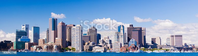 Panoramic view of the Boston City Skyline viewed from East Boston across the Inner Harbour, USA. Early morning with first of the sunlight.
